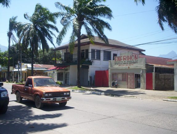 A shop selling air conditioning in La Ceiba. Pico Bonito Mountain in the far right background