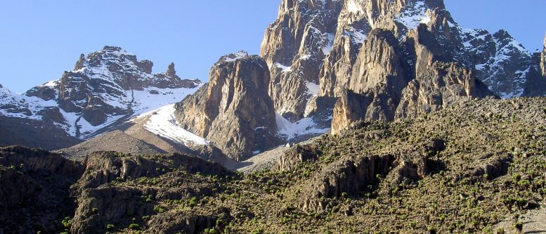 The central peaks of Mount Kenya are volcanic plugs that have resisted glacial erosion.[7] (Left to right: Point Thompson (4955m), Batian (5199m) and Nelion (5188m))
